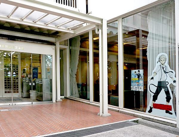 Manga protagonist Atsushi Nakajima displayed by the main entrance