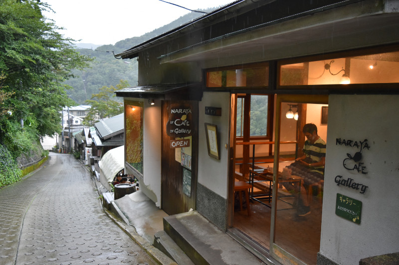 A popular cafe with foot baths from a stream flowing from a ryokan established in the Edo Period!